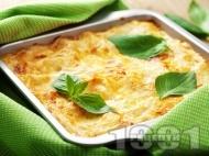 Лазаня с пилешко месо (филе), синьо сирене, жълтъци и сметана, залята със сос Бешамел